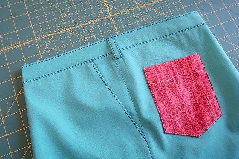 наклонный карман в брюках, юбке